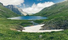 Lake and Mountains spring landscape, an epic alpine view, blue water and green meadows. Traveling in the wild. Spring Landscape, Mountain Landscape, Mountains, Water, Green, Travel, Water Water, Trips, Viajes