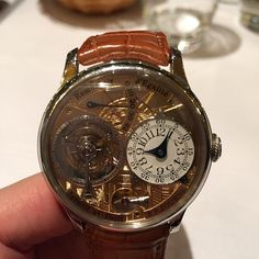 Instagram media pdlerner - Had to come to Geneva to see a #fpjourne watch from someone in Hong Kong Tourbillon Unique with a gold engraved dial with the Statue of Liberty #jawdropping #sihh2015