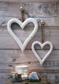 Pair of wooden heart decorations with a distressed white finish, hanging from rope. Larger heart measures cm, and small heart measures cm Heart Diy, Heart Crafts, Shabby Chic Hanging Hearts, Wooden Hearts Crafts, Bedroom Colour Palette, Heart Wall Decor, Diy Pallet Wall, Heart Decorations, Hanging Decorations