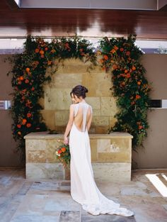Wedding Arch in Dramatic Orange and a Backless Wedding Dress   Allen Tsai Photography   http://heyweddinglady.com/edgy-modern-wedding-dramatic-blood-orange-black/