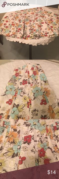 CAbi Floral Print Skirt Cute Floral Print CAbi Skirt. Size 6. Print background is off-white with floral print containing brown/blue/green/red/yellow-gold. Unlined. Back Zip. 100% Cotton. Measurements approximately as follows: waist 15 inches and length 26 inches. Very flattering on. In good preowned condition. Please ask all questions prior to making an offer or purchase. Thanks for looking! CAbi Skirts