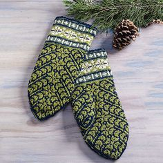 My connection to Erna Jansons began in 2005, shortly after she published her book Latviešu Cimdu Raksti Latvian Mitten Designs. The book contains one hundred mitten designs by this lovely and clever Latvian woman, with her handpainted illustrations of each mitten. The colors and motifs of this pair of mittens are based on Design No. 51.