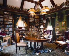 In a turn-of-the-century Shingle/Colonial Revival house, the master's library has an old English feel and is crammed with paintings, collections, maritime memorabilia, a rifle—and books. (Photo: Eric Roth)