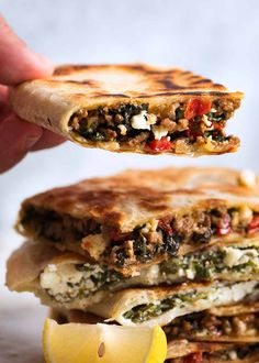 Hand holding beef and spinach gozleme Turkish Flatbread Recipe, Flatbread Recipes, Samosas, Quesadillas, Gozleme Recipe, Beef Recipes, Cooking Recipes, Yummy Recipes, Chicken Recipes