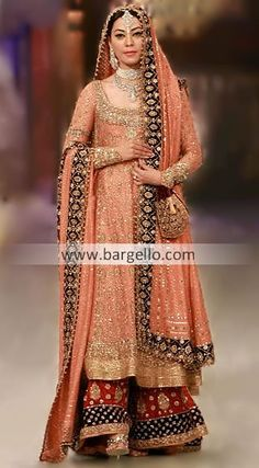 Sharara in Golden  Zariwork  on a combination of bold peach and bright maroon tinge.