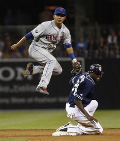 Game #110 8/4/12: New York Mets shortstop Ruben Tejada hurdles San Diego Padres' Cameron Maybin while completing a game-ending double play that gave the Mets a 6-2 victory in a baseball game Saturday, Aug. 4, 2012 in San Diego. (AP Photo/Lenny Ignelzi)