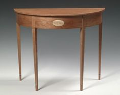 Half-Round Hall Table, by Jason Breen of Brattleboro VT. This table features birch, walnut, and poplar inlay, the primary wood is cherry.