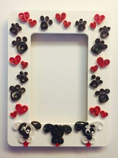 Quilled Frame with paw prints, hearts and dogs.