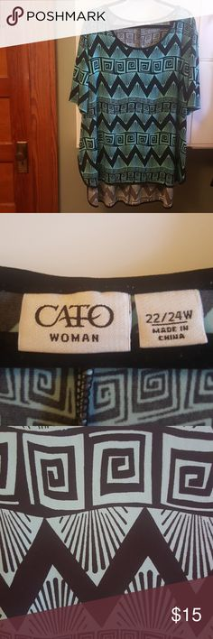 Cato woman 2224 tribal high low top This Cato woman hi low top is in good used condition. It features a teal and black Tribal Design it is 92% polyester 8% spandex. It is a 22w / 24w Cato Tops Blouses