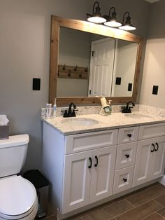 17 Fresh & Inspiring Bathroom Mirror Ideas to Shake Up Your Morning Lipstick Routine Hall bathroom update Benjamin Moore Coventry gray paint. Bathroom Mirror Makeover, Bathroom Mirror Design, Bathroom Lighting Design, Hall Bathroom, Bathroom Vanities, Bathroom Ideas, Bathroom Updates, Framed Bathroom Mirrors, Master Bathroom