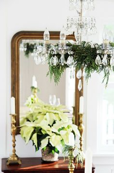 Crystal chandelier with greenery clippings. So pretty, looks very similar tO our dining room chandelier.   A Country Farmhouse: 'Tis the Season