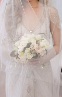 It's #weddingwednesday and we're crushing on this veiled beauty! Photo by @greerg, bouquet by @kimstarrwise, @raceandreligious #bride #veil #neworleanswedding #neworleansweddingplanner