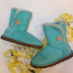 Bright Mint/Robins Egg Bailey Button UGGs I wore these once but they're still in lovely condition with just a small mark on the left boot (see photograph) and a little mark where the stickers were taken off of the bottoms.  Rare color! UGG Shoes Ankle Boots & Booties