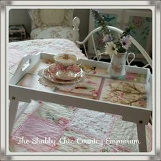 Bed breakfast table shabbied up with a canvas print used on the tray.