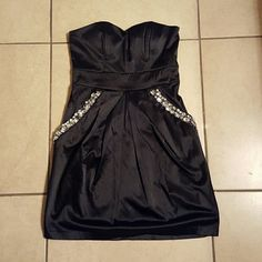 Little black dress Simple black dress with a nice touch of bling ...pockets are located behind rhinestones great for holding a phone or lipstick..pockets are very roomy and no one but u knows they r there..all rhinestones in tact...has plenty of life left it in it...30or best offer im very negotiable city triangle  Dresses Mini