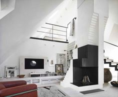 This amazing studio loft designed by Swedish interior designer Carouschka Streijffert is located in beautiful Stockholm. It's a geometric masterpiece is nestled a top a historic building, and features plenty of oddly placed circular windows that allow a large amount of natural light to illuminate the residence.