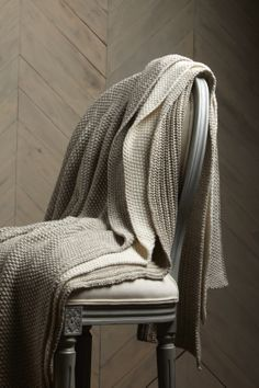 Stitch up cozy with these moss-stitched blankets.
