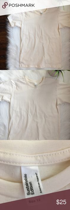 NWOT American Apparel Sustainable Tee Cream Color American Apparel Sustainable edition Tee. Never been worn. NWOT. Never been washed either. Great condition. Size 12 fits like a small American Apparel Tops Tees - Short Sleeve