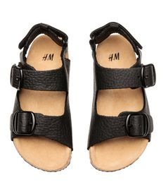 Black. PREMIUM QUALITY. Sandals in grained leather, Adjustable foot straps with metal buckles and concealed elastication. Adjustable heel straps with