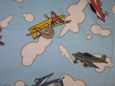 Colorful Glider Planes on blue cotton knit fabric