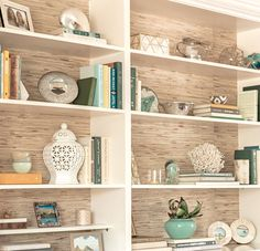 Rosa Beltran Design {Blog} LIVING ROOM BY ROSA BELTRAN DESIGN LOS ANGELES bookshelf styling before and after before & after book case bookshelf book shelf shelves bookshelves how to inspiration built-in builtin built in living room tutorial tips on for how to style seagrass wallpaper backing sea grass coral nautical beachy beach coastal bookends mercury glass