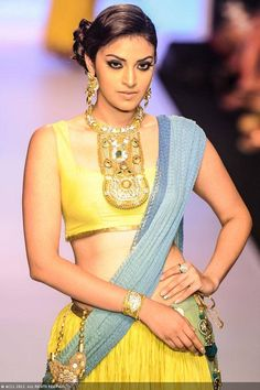 A model walks the ramp for Dipti Amisha during the India International Jewellery Week (IIJW), held at Grand Hyatt, Mumbai, on August 06, 2013.