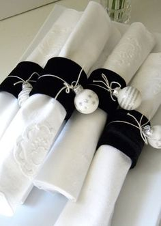 Christmas - white napkins, black velvet band, white and silver mini ornaments tied with silver string