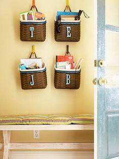 Hang Baskets Near an Entry  Combat clutter buildup near the main entry: Install hooks at each family member's height and hang personalized baskets. These stash everyday items such as sunglasses, keys, sunblock, small pieces of outerwear, and more to help maintain a manageable, tidy entryway.