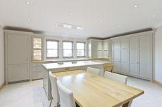 Hardwick white cabinets and skimming stone walls