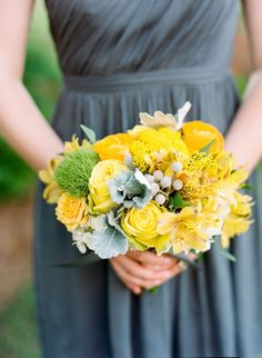 Sunny-hued bridesmaid bouquet: http://www.stylemepretty.com/north-carolina-weddings/charlotte/2015/10/06/romantic-sunny-hued-wedding-with-touches-of-gorgeous-gray-in-north-carolina/ | Photography: Faith Teasley - http://www.faithteasley.com/