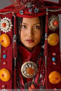 Tibet | Traditional regional costume and headdress of Khampa Tibetans.