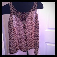 Leopard Hi- Low Tank -lace detail along the side Leopard Hi- Low Tank with lace detail along the side seams. Front is leopard back is a soft baby pink color. In excellent condition! No signs of wear, rips stains or flaws. Comes from a smoke free and pet free home. Buffalo Tops Tank Tops