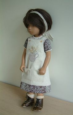 These aprons can be removed and dresses worn on their own