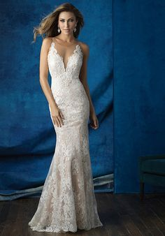 Sheer illusion netting creates an ethereal silhouette at the neckline and back of this lace sheath.