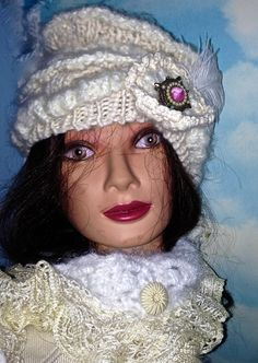 OOAK Warm Knitted Cream Colored Dr Zhivago Style Hat.    Crocheted, trim and vintage pin. $55.00, via Etsy.