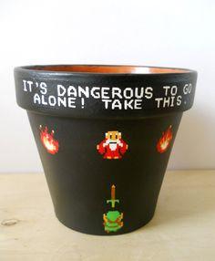 Legend of Zelda Nintendo NES Painted Flower Pot -It's Dangerous to Go Alone. $25.00, via Etsy.