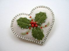 Hi! This holiday heart pin, is made of 100% wool felt, and it measures just over 2 1\/2 across. Onto creamy off white felt, Ive add a few holly