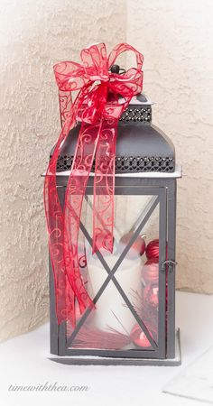 Christmas Decorated Outdoor Lantern ~ Decorate a basic black outdoor lantern for the Christmas season with red sparkling sprays, ornaments and ribbon. Christmas Planters, Christmas Minis, Christmas Projects, Winter Christmas, All Things Christmas, Holiday Crafts, Christmas Time, Christmas Decorations, Christmas Ideas