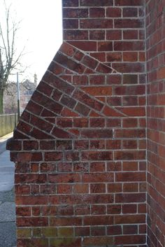 Tumbling in brickwork on buttressing