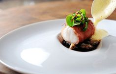 Monkfish wrapped in Parma ham, with red wine jus, lemon sabayon and cockles - Chris Horridge