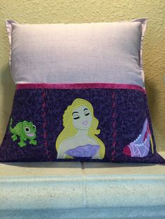 A personal favorite from my Etsy shop https://www.etsy.com/listing/275356548/designer-punzie-remote-control-pillow