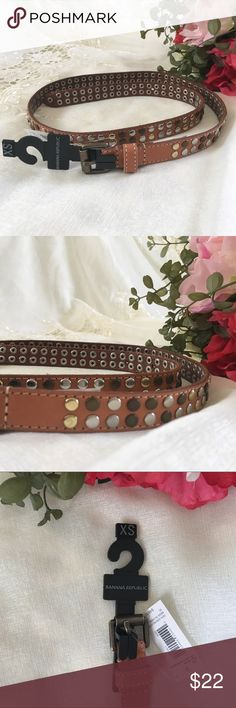 "Banana Republic XS Tan Studded Belt NWT New with tag Tan XS Banana Republic belt.   Multi-colored metal toned studded belt. Buckle is brass colored.   So cute!   Size: XS.  Length. 35"". Width 3/4"" Material:  100% Genuine Leather Banana Republic Accessories Belts"