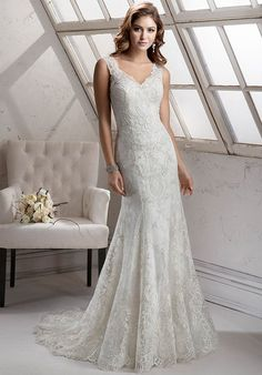 Elegant embroidered lace with shimmering metallic accents on tulle adorns this Marcelina satin sheath, complete with stunning illusion back and delicate lace sleeves. Finished with covered buttons and inner elastic zipper closure.