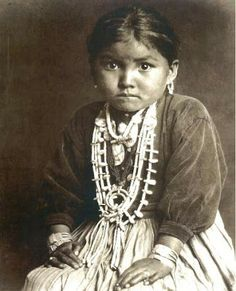 Navajo child wearing traditional jewelry.
