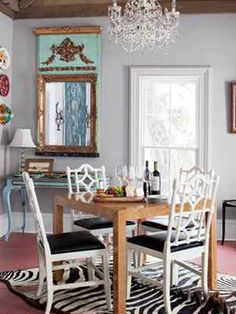 Show off your eclectic style! A zebra rug in the dining room does the job well.     #decorating #personalstyle
