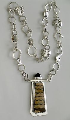 bernardine fine art jewelry.  (I like the chain idea of solid spacers, could be words-little stones etc.)