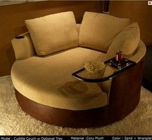 Awesome cuddle couch. With a table! I'd love to wrap up in a blanket with a sweetheart and enjoy a movie in this.