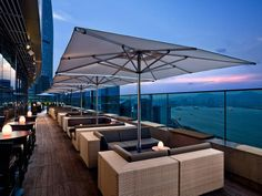Hong Kong - Have a drink on a rooftop bar and watch the sun set over the city skyline. Sugar at East hotel is a great rooftop bar.