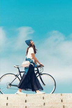 Bike, girl and blue sky