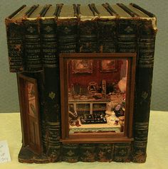 """The exterior of the 1:12 scale roombox """"Ode to Susan Harmon"""" built into a set of recycled books by Janey Elliot."""